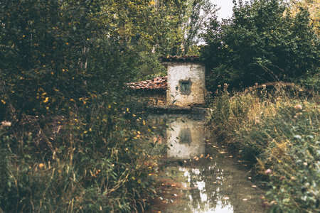 Old mill at the edge of a river. Spain