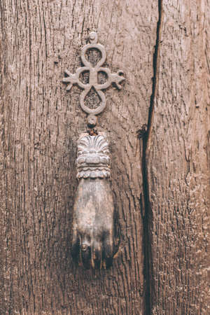Antique door knocker with hand shape