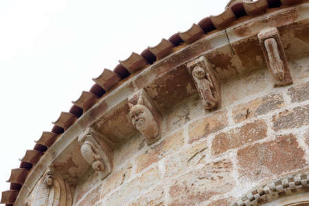 Detail of the church of San Clemente, Huidobro. Romanesque temple of the XII century. Burgos, Castilla y Leon, Spain Stock Photo