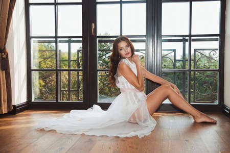 boudoir: Beautiful sexy girl in boudoir white dress