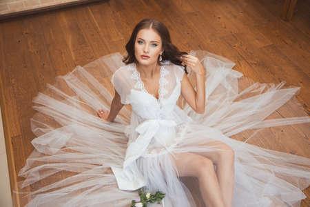 boudoir: Beautiful sexy girl in boudoir white dress