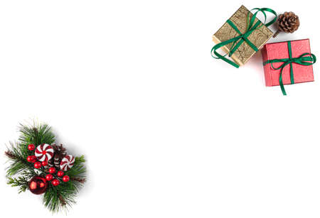 Christmas composition. Gold and red gifts and Christmas decoration on white background. Flat lay. Top view.