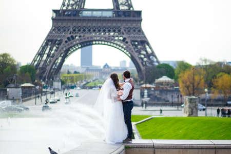 Happy bride and groom enjoying their wedding in Paris