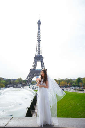 young woman walks in white lace dress, high-heeled shoes, Paris, Banque d'images