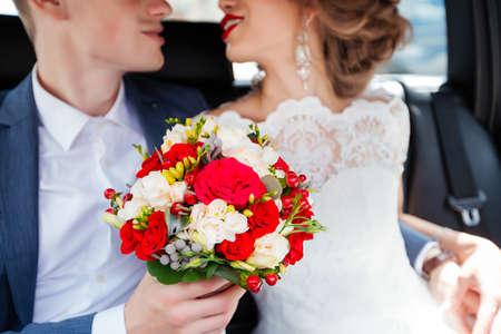 brides in a car driving through the city.