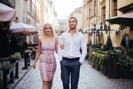 Smiling couple in love outdoors, lviv. summer Standard-Bild