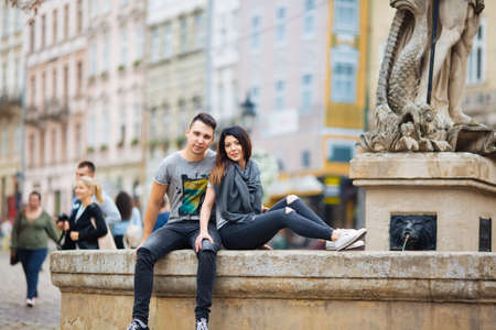 couple posing on the streets of a European city in summer weather.