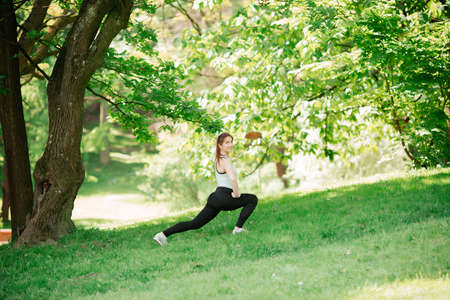 Athlete doing warm-up outdoors. Sports concept