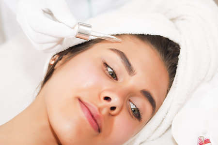The concept of health, beauty, spa and leisure - beautiful woman and spa receiving massage