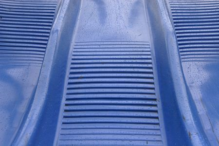 Close-up view of a blue slide showing its texture Stock Photo