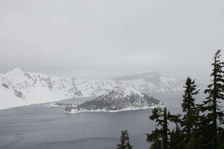 crater lake: Wizard Islnad at Crater Lake as a winter storm begins.