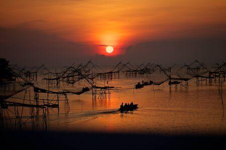 chinese fishing nets: Chinese fishing nets with sunset view Stock Photo