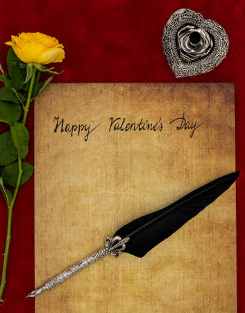 Classic Happy Valentine's Day card hand written on parchment yellow rose ornate silver quill and stand on burgundy velvet top view