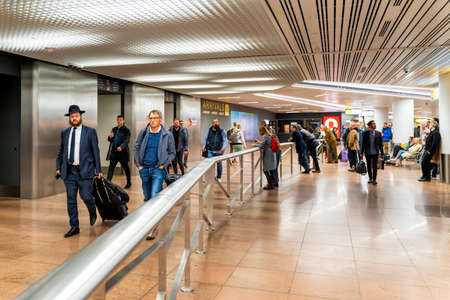 Brussels, Belgium, May 2019 Brussels airport, people waiting and going to meet their friends and families, arrivals hall Editorial