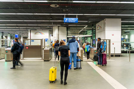 Brussels, Belgium, May 2019 Brussels, airports underground train station entrance, people at automatic ticket control for train