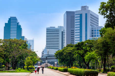 View at Bangkok skyscrapers from Lumpini city park, green oasis in modern busy city