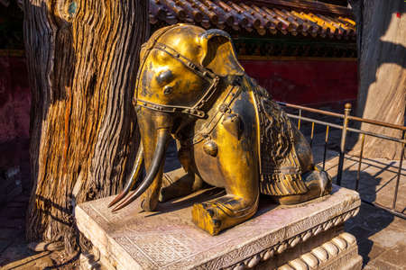 The bronze sitting elephant in the Forbidden City, popular tourist attraction, Beijing, China