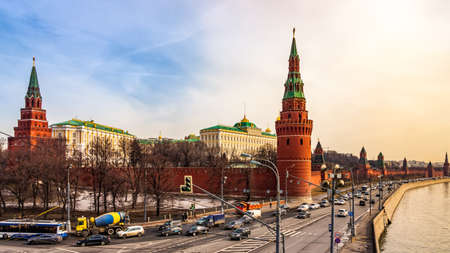 Wide panoramic view at Kremlins surrounding red walls with Borovitskaya and Vodovzvodnaya Towers, heavy traffic and Moskva River, Moscow, Russia