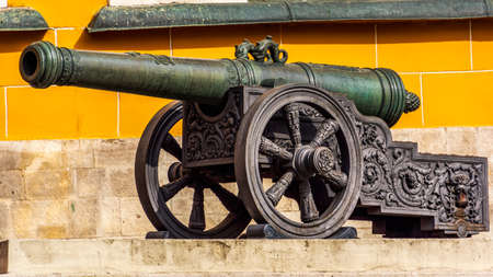Old tarnished ornate canon on wheels inside the Kremlin in Red Square, Moscow, Russia 版權商用圖片