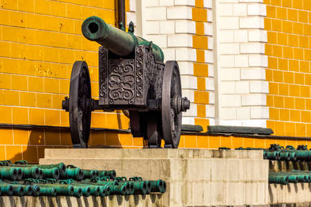 Old tarnished ornate canons on wheels inside the Kremlin in Red Square, Moscow, Russia