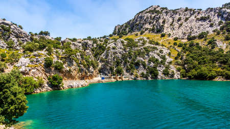 Water dam at Embassament de Cuber, it is an artificial lake, water reservoir, located at the valleys of Puig Major and Morro, Mallorca, Spain