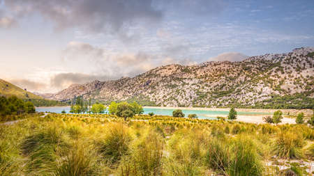 Embassament de Cuber is an artificial turquoise colour lake, water reservoir, located at the valleys of Puig Major and Morro, Sunset, Mallorca, Spain
