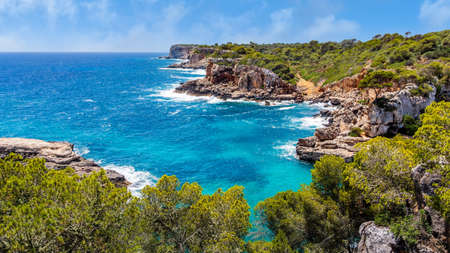 Panorama of beautiful beach and bay with turquoise sea water, Cala des Moro, Santanyi, Mallorca island, Spain
