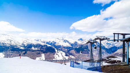 Beautiful mountains in winter, slopes and pistes with ski lifts, ski and snowboard holidays, Livigno village, Italy, Alps