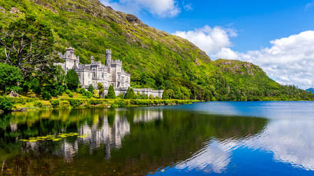 Kylemore Abbey, beautiful castle like abbey reflected in lake at the foot of a mountain. Benedictine monastery founded in 1920, in Connemara, Ireland