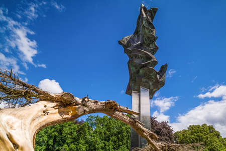 Szczecin, Poland, June 2016 Monument of Deed of Poles in the form of Three Eagles at a Kasprowicz Park with wooden branch in foreground