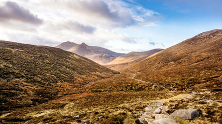 Footpath leading to beautiful valley in autumn colours with Mourn Mountains in background. Most dramatic and highest range in Northern Ireland
