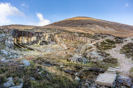 Old stone quarry in Mourne Mountains on the hill of Slieve Donard mountain. This mountain range is the highest and most dramatic in Northern Ireland. Stock Photo