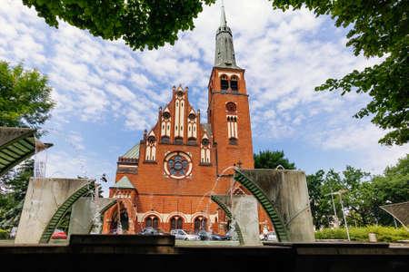 Fountains and pond in front of Roman Catholic church Saint Wojciech in Szczecin, Poland Stock Photo