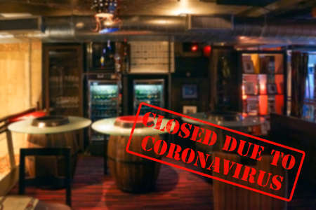 Defocused, blurred view of interior of an upmarket bar or pub, empty and closed due to coronavirus or covid 19 pandemics Stock Photo