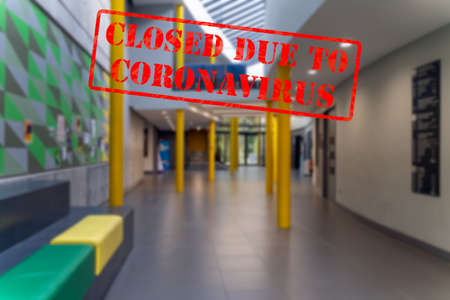 Defocused, blurred view of interior, entrance or corridor of school or college, empty and closed due to coronavirus or covid 19 pandemics