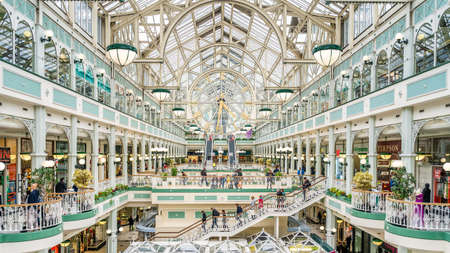 Dublin, Ireland, April 2019 People shopping in the Stephens Green Shopping Centre. Modern complex located in the Grafton Street, famous shopping area Reklamní fotografie