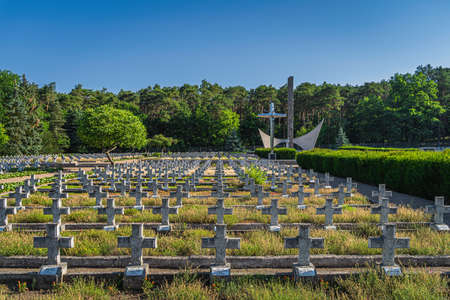 Stare Lysogorki, Poland, June 2019 Monument and rows of graves. Military cemetery for fallen soldiers from 1st Polish Army which participated in crossing of Oder River as part of the Berlin operation