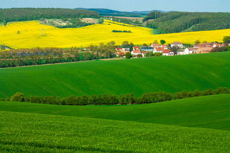 moravian fields in czech republic. rural life during a sunny spring. arable fields prepared for sowing the grain. green background