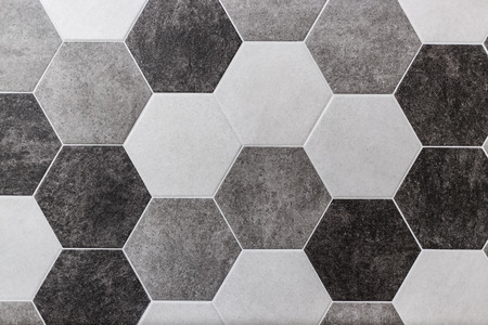 large hexagonal background. Concrete structure, shades of gray. Close-up of hexagon tiles in kitchen. 免版税图像
