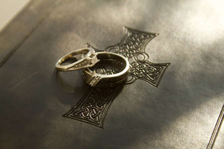 christian marriage: Wedding Rings on a Bible Stock Photo