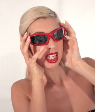 Woman with horrified expression, reflection of man in her sunglasses screaming. photo