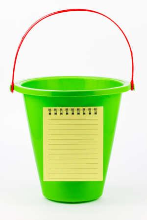 A blank to do list on a green beach bucket. Stock Photo