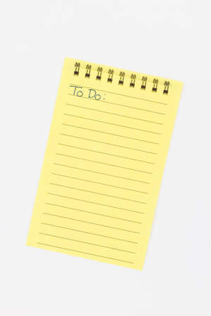 A sheet of lined yellow paper with To Do written on it. Imagens