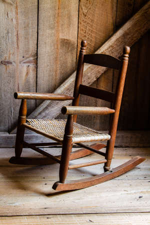 rocking chair: A child s rocking chair  Stock Photo