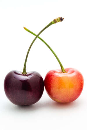 A rainier and black cherry isolated on a white background  photo