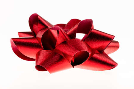 Red textured bow isolated on a white background
