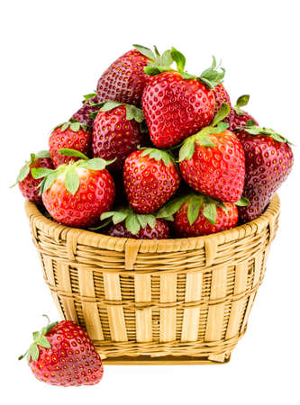 Ripe strawberries piled high in a wicker basket isolated against a white background  Stock Photo