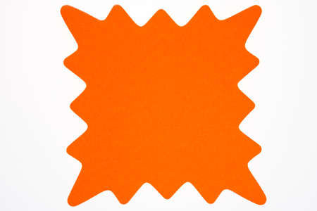 A blank orange star shaped sign usually used to advertise sales and specials isolated on white