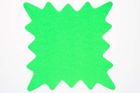 A blank green star shaped sign usually used to advertise sales and specials isolated on white
