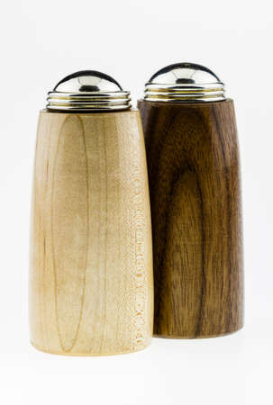 Wooden salt and pepper shakers on a white background  版權商用圖片
